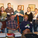 Bill Walmsley with a Museum Studies class installing works from his collection.