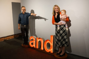 "Kevin Curry and his family demonstrate his sculpture Conjunction at ""The Faculty Annual."""