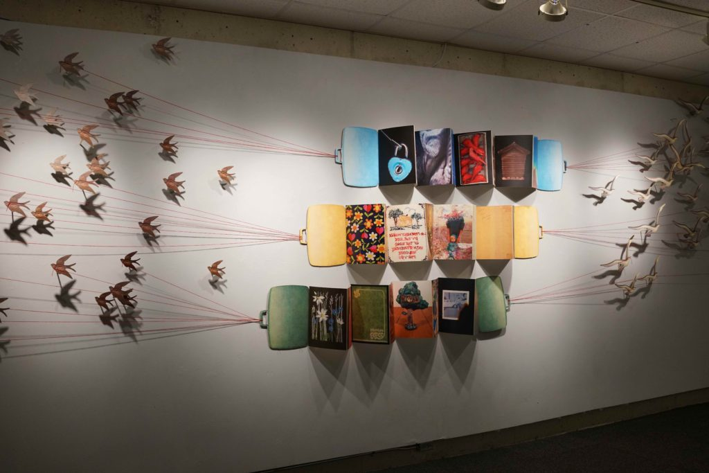 Molly Reilly; Tethered; installation: color laser prints on card stock paper / wood / string; books: archival inkjet paper printed with Epson Ultrachrome ink; 2009