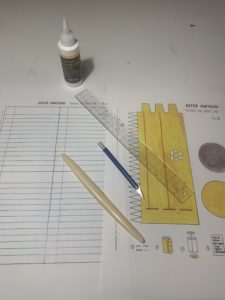Paper, ruler, pencils, and print-outs.