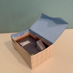 Open paper box. Blue interior.