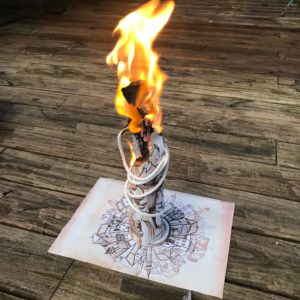The paper tower has now been lit on fire.