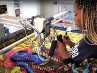 Bisa Butler working at a sewing machine in studio.