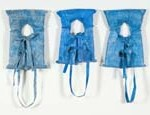 "Tim Waldrop Life Vest Triptych (Post Katrina), found tarps, polystyrene foam, thread, 24"" x 17"" x 3"" each"